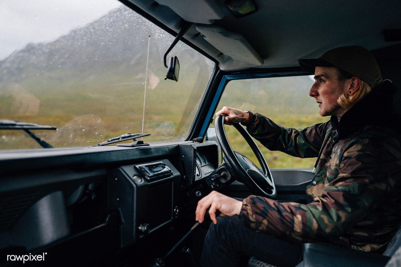 Man driving an old SUV in the Highlands free image by