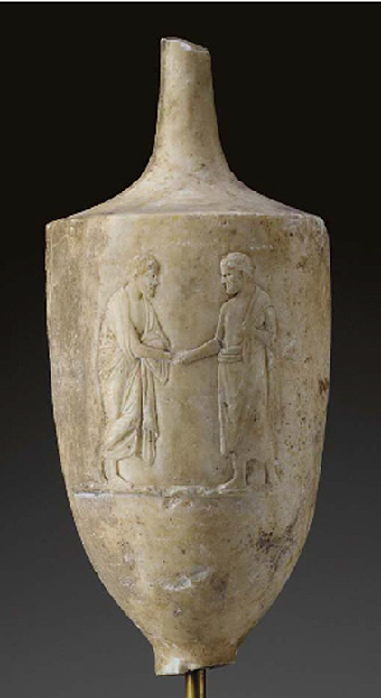 A GREEK MARBLE LEKYTHOS   Attic, Classical Period,  Circa 4th Century B.C.  The funerary vessel sculpted in shallow relief with a departure scene, a bearded man to the left, standing with his left leg crossed over his right, his heel raised, wearing a mantle wrapped around his body, his chest exposed, leaning slightly forward and clasping hands with the standing bearded man facing him, wearing a mantle draped around his waist and over his left shoulder, on a thin groundline