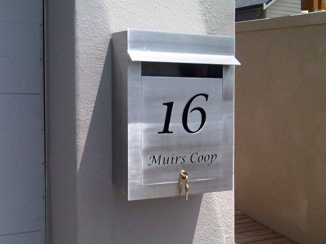 External Portrait Stainless Steel Letterbox with cut-out text in the on icon house, label house, chart house,
