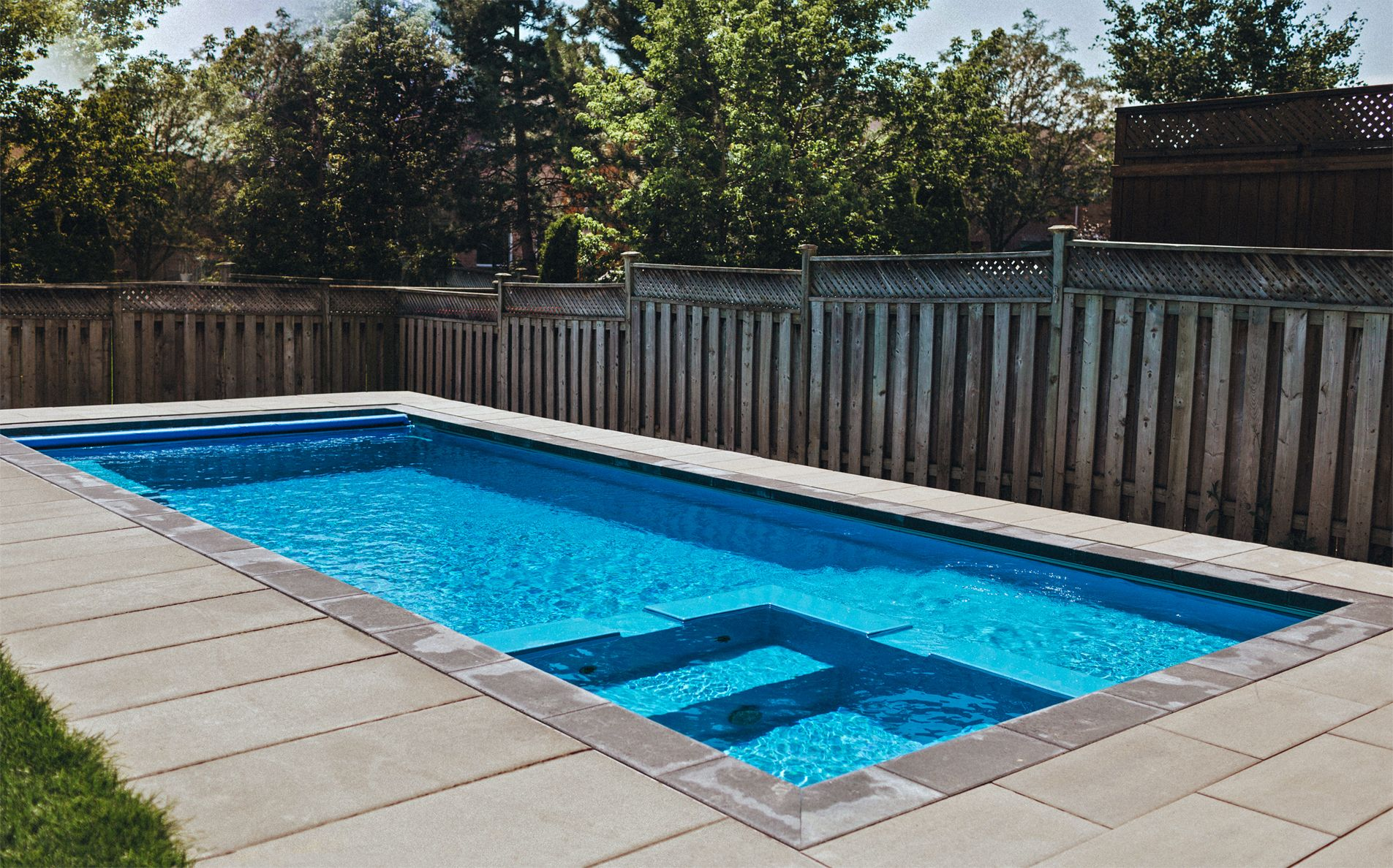 The Leisure Pools Limitless Composite Fiberglass Swimming Pool Offers You A Built In Spa A Splash Backyard Vacation Leisure Pools Fiberglass Swimming Pools