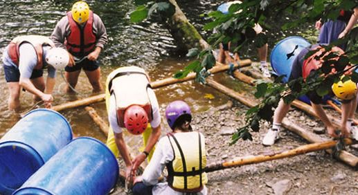 Raft building and racing team building activity.