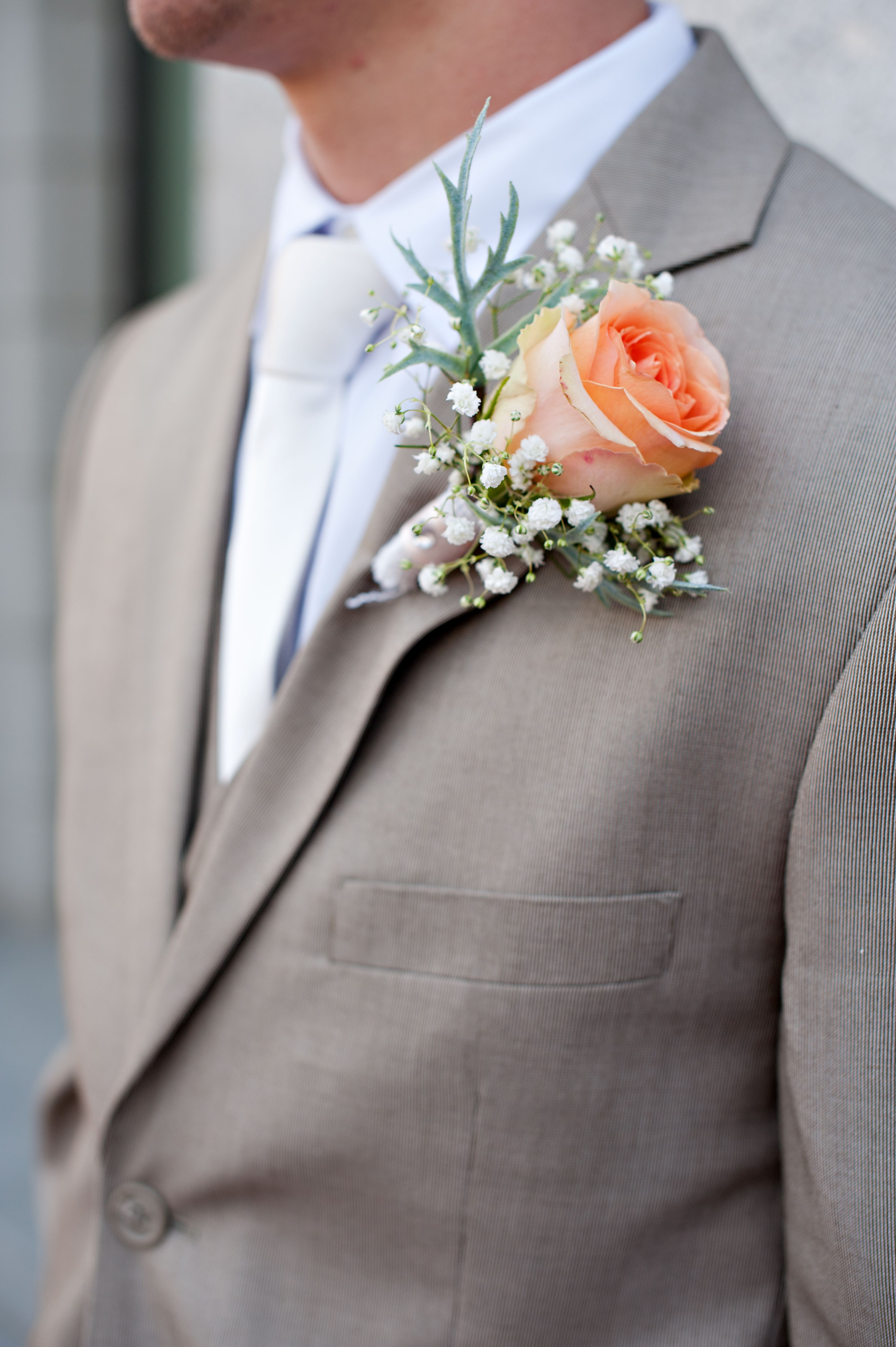 light grey suit for cyle cream or white ties coral flower and no jackets