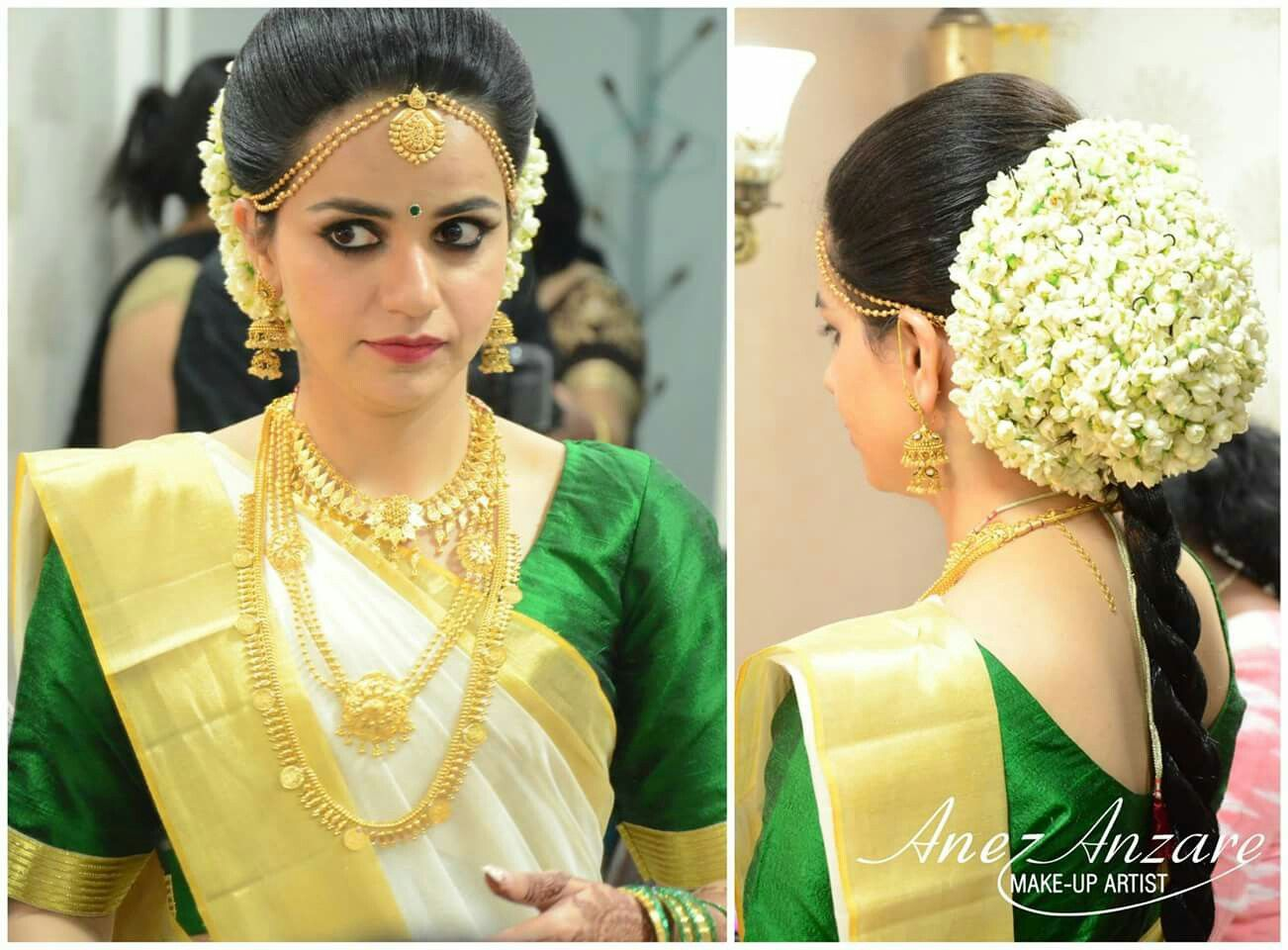 What A Beautiful Large Low Bun Covered With Flowers Care However Should Be T Hairstyles Kerala South Indian Wedding Hairstyles Bridal Hairstyle Indian Wedding