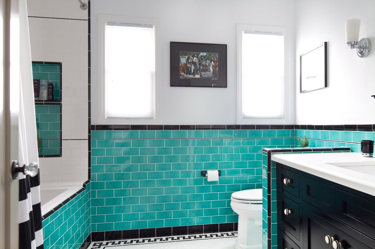 Intricate tile work is on display in this remodeled bathroom. The ...