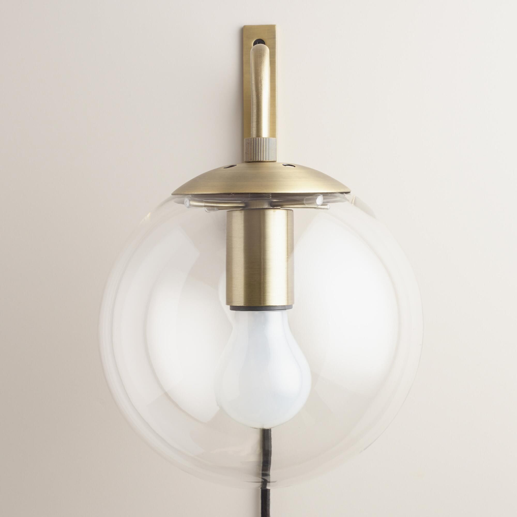 Brighten any corner with our exclusive globe wall sconce, crafted of ...