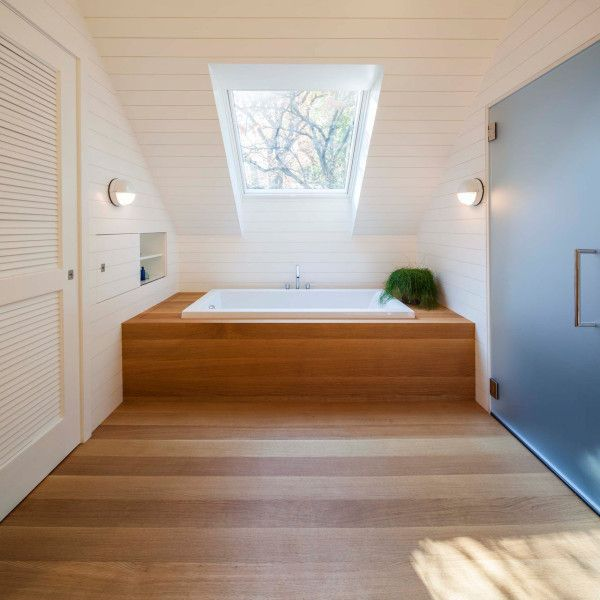 wood enclosed tub.