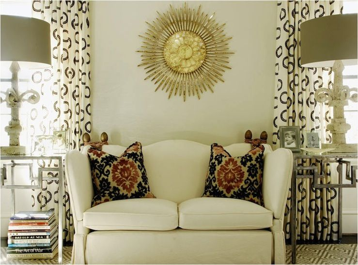 Chic Living Room Design With Ivory Walls Paint Color Gold Sunburst Mirror White Settee