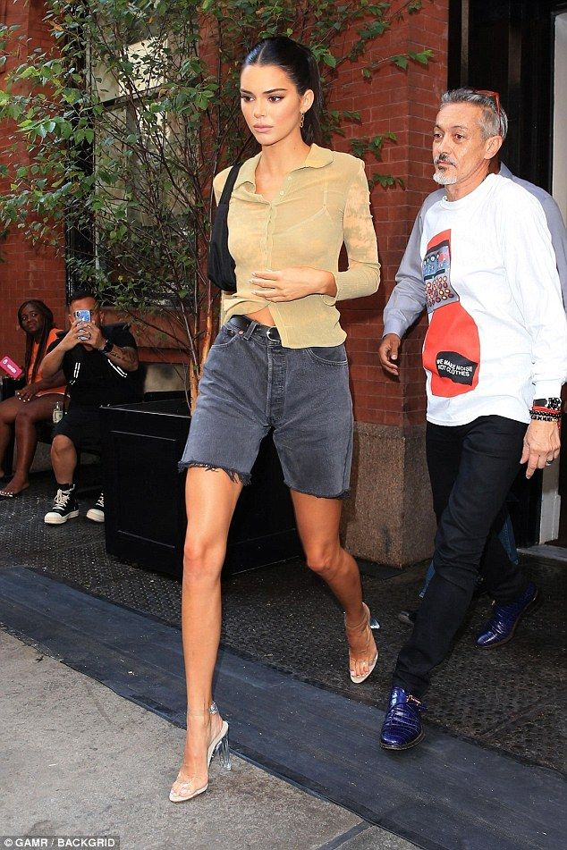 Kendall Jenner puts on leggy display in cut-off shorts with sheer top – Street Style