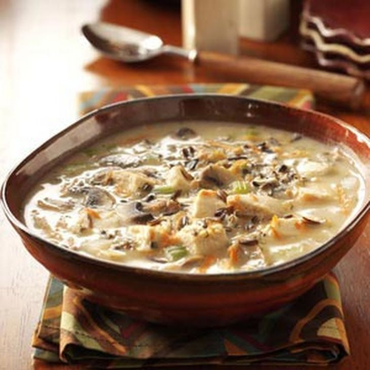 Chicken Wild Rice Soup Recipe Soups with chicken broth, fresh mushrooms, chopped celery, shredded carrots, finely chopped onion, chicken bouillon granules, parsley flakes, garlic powder, dried thyme, butter, all-purpose flour, condensed cream of mushroom soup, dry white wine, wild rice, cooked chicken