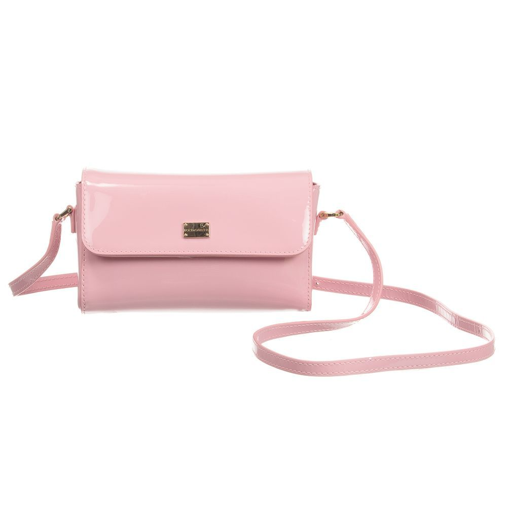 d078b336ddb6 Girls pink patent leather shoulder bag from Dolce   Gabbana. This luxury  design has an adjustable shoulder strap