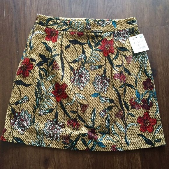 Zara Floral Mini Skirt Beautiful mini skirt by Zara. Has a smooth almost velvet feel to the touch. Tan/Brown in color with various colored flowers all over front and back. Features a hidden side zipper. Purchased without trying on and unfortunately it's to small for me.  Runs true to size. 98% Cotton, 2% Elastane. This item is also available on Vinted  Zara Skirts Mini
