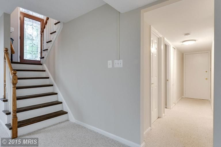 Open Up The Lower Level Of A Split Foyer Light Bright And I Love The Stairs Contrasting Wood With Split Foyer Basement Flooring Options Split Level Remodel