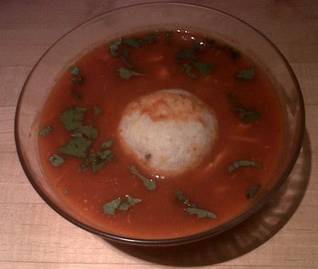 Pozole with matzo balls soup contains hints of chili, tomato and hominy.