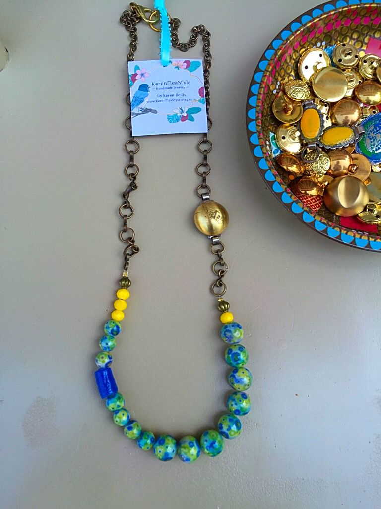 Green statement necklace made with vintage jewelry elements by KerenFleaStyle