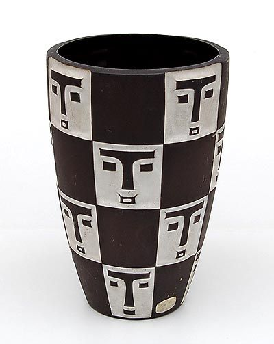 Earthenware vase with relief-decoration of masks design executed by Jaap Ravelli / the Netherlands ca.1955