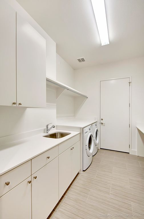 Contemporary Laundry Room With Designer White Solid Surface Countertop Corian Undermount Sink Seneca Cabinetry