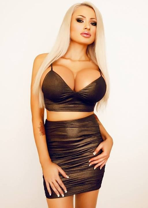 Sexy bimbo blonde showing her tits gif