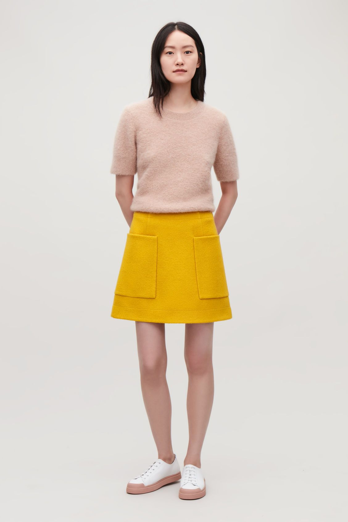 225f9a35af3e66 Model front image of Cos boiled wool a-line skirt in yellow ...