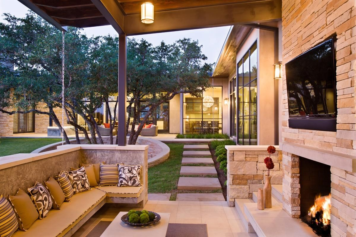 family home with outdoor living room and pool outdoor living