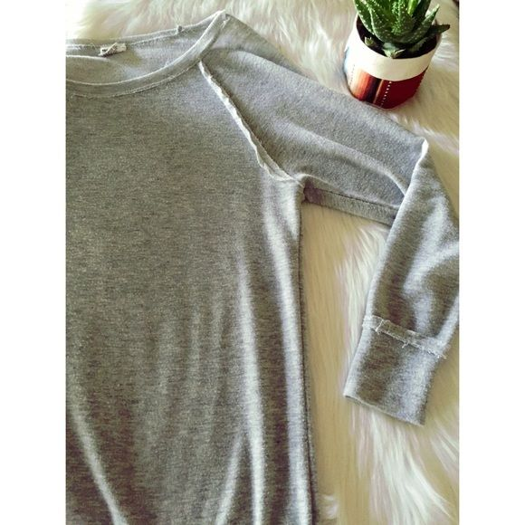 Off Shoulder soft grey long sleeve Slight pilling on top but still cute with yoga pants or jeans! Size small but I'm normally a medium. The model's top is darker than this top. Full Tilt Tops Tees - Long Sleeve