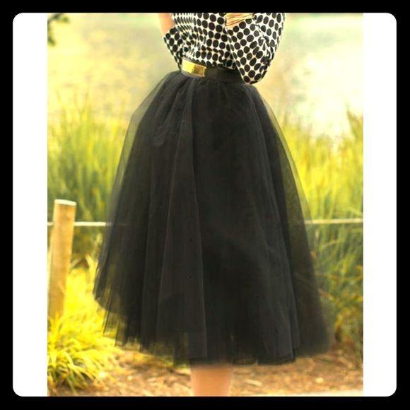 Black tulle skirt Black tulle skirt mid- calf, with elastic waste band. Brand new!!! Skirts Midi