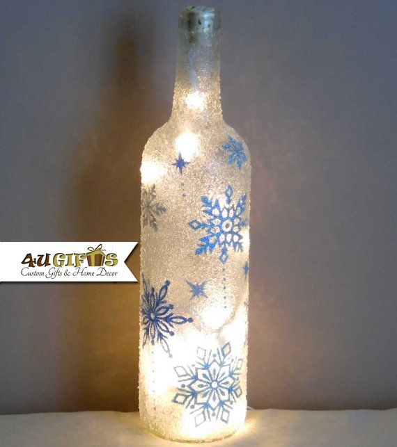 Christmas Snowflakes Shimmery Lights Decorated And Lighted Wine Bottle Wine Lovers Gift Christmas Wine Bottles Wine Bottle Diy Crafts Wine Bottle Crafts