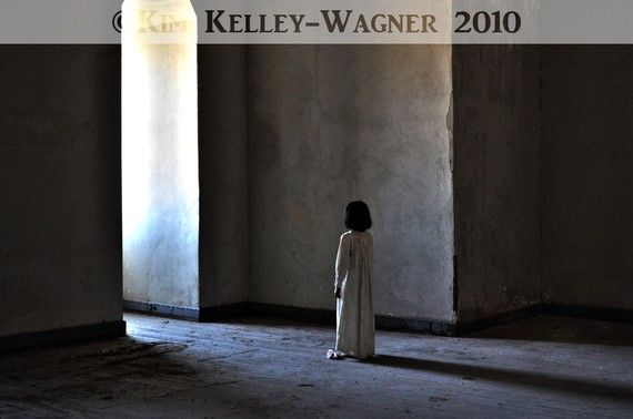 i have this photo framed in my home. it is from 'The Ghosts Library' series from Kim Kelley Wagner (photographer)
