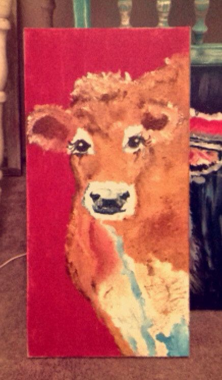 This is a hand painted cow is on a burlap canvas, I chose that type of canvas for a more country feel. She's perfect for a long wall, family room or kitchen.