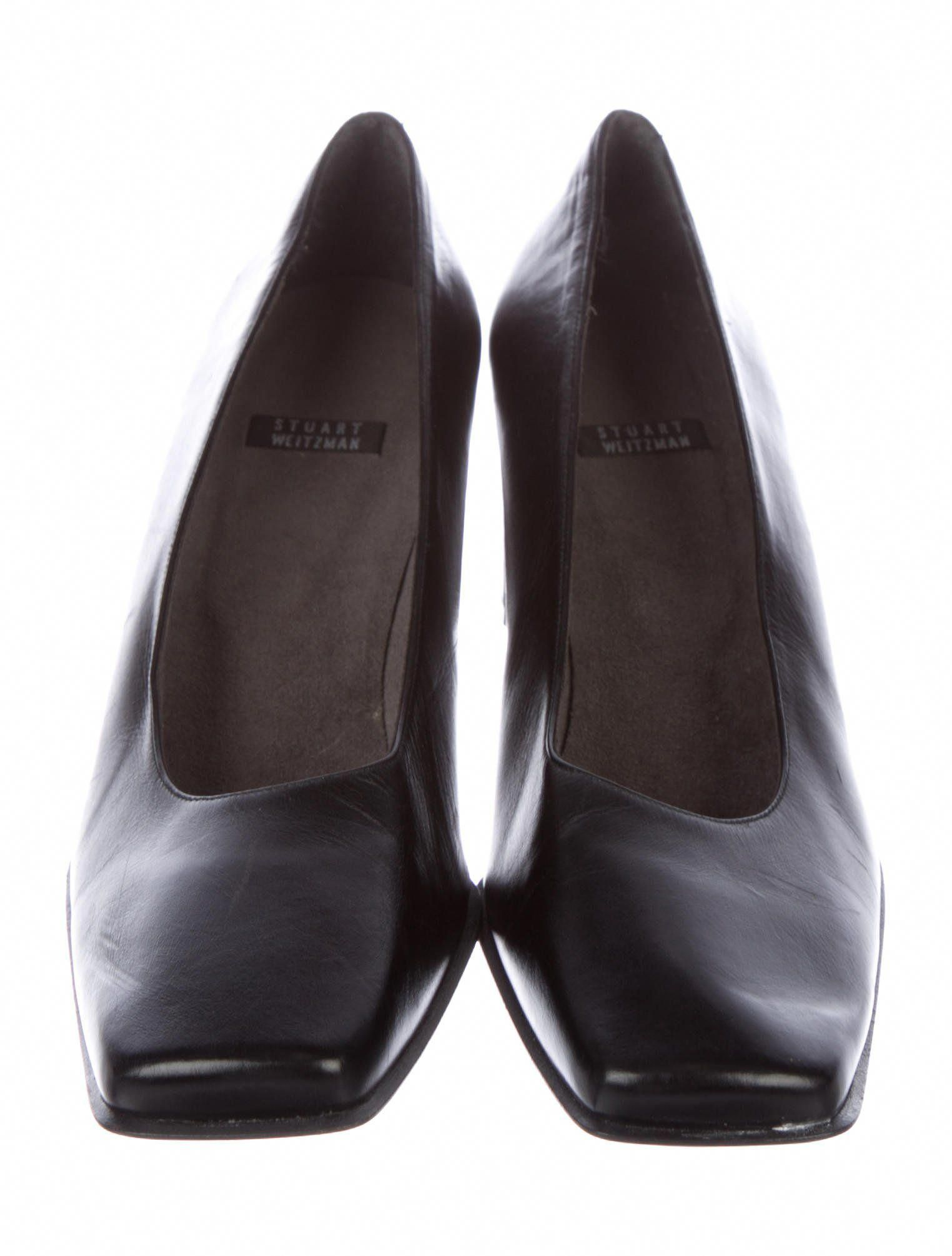 70bde033094 Black leather Stuart Weitzman square-toe pumps with covered block heels.   StuartWeitzman