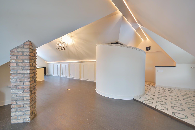 Brick Pillars A Bathroom Remodel With Hexagonal Tiling And Open Space Attic Renovation Attic Remodel Attic Design