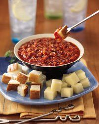 Pizza fondue! Melted cheese in white wine and tangy tomato sauce spiked with fine herbs *drool*