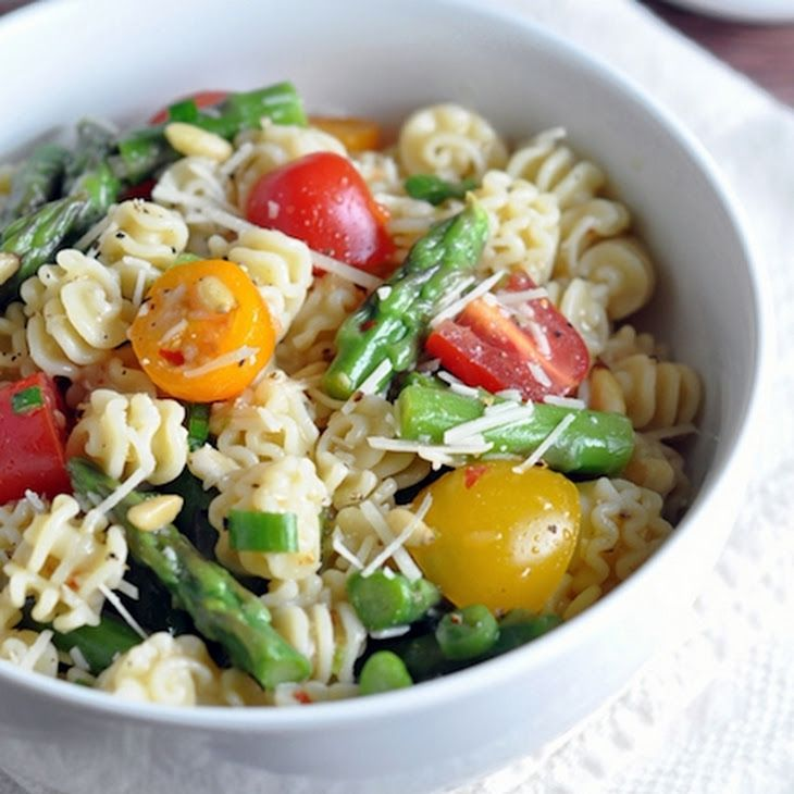 Italian Summer Pasta Salad Recipe Salads with short pasta, asparagus, cherry tomatoes, pinenuts, scallions, shredded parmesan cheese, italian salad dressing