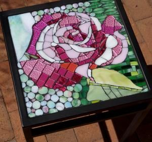 Glass mosaic rose on wrought iron table. R2000.00 SOLD