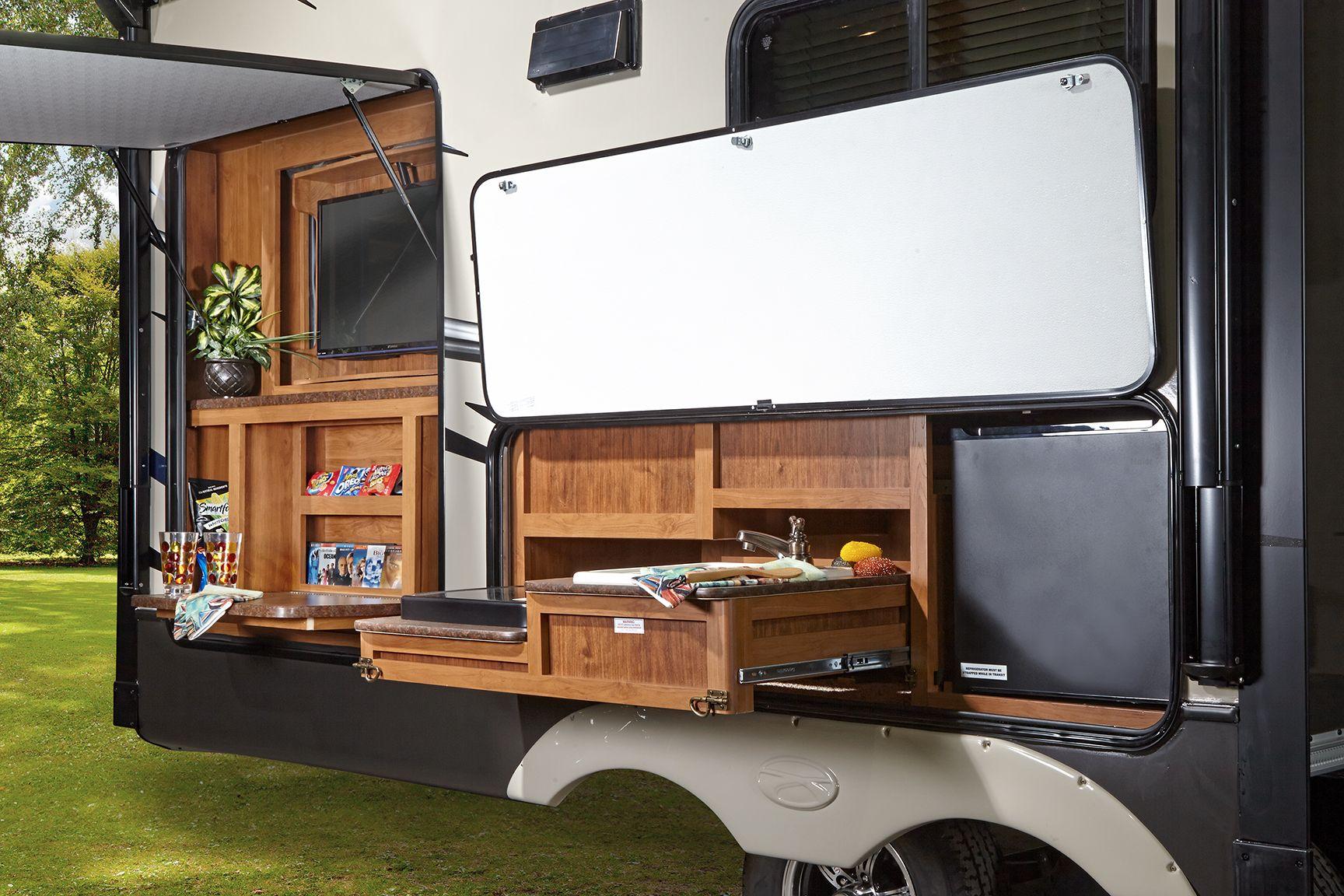 Image result for rv exterior storage ideas | Tiny House Design Ideas on motor coach outdoor kitchen, camper leveling jacks, trailer kitchen, rv kitchen, small camper kitchen,
