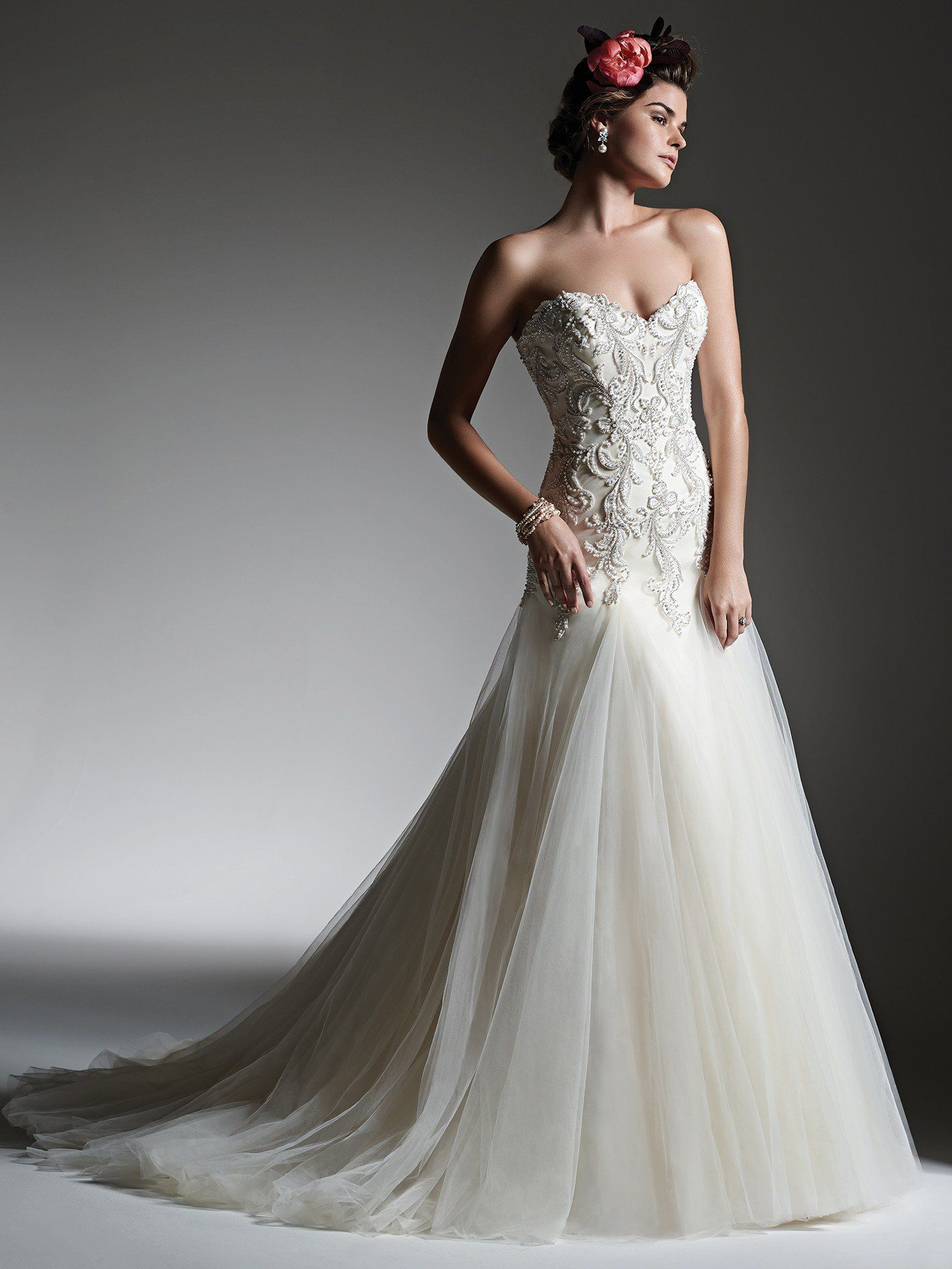 LIKE THE FLAIR CONNECTION  Sottero and Midgley - IDALIA, Delicate pearls, dazzling Swarovski crystals and shimmering beads adorn the bodice of this A-line wedding dress with a flowing tulle skirt. Finished with sweetheart neckline and pearl buttons over zipper closure and inner corset closure.