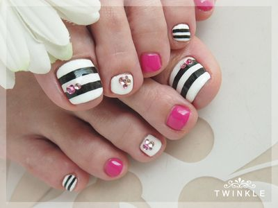 Black, pink and white. Rhinestones and stripes