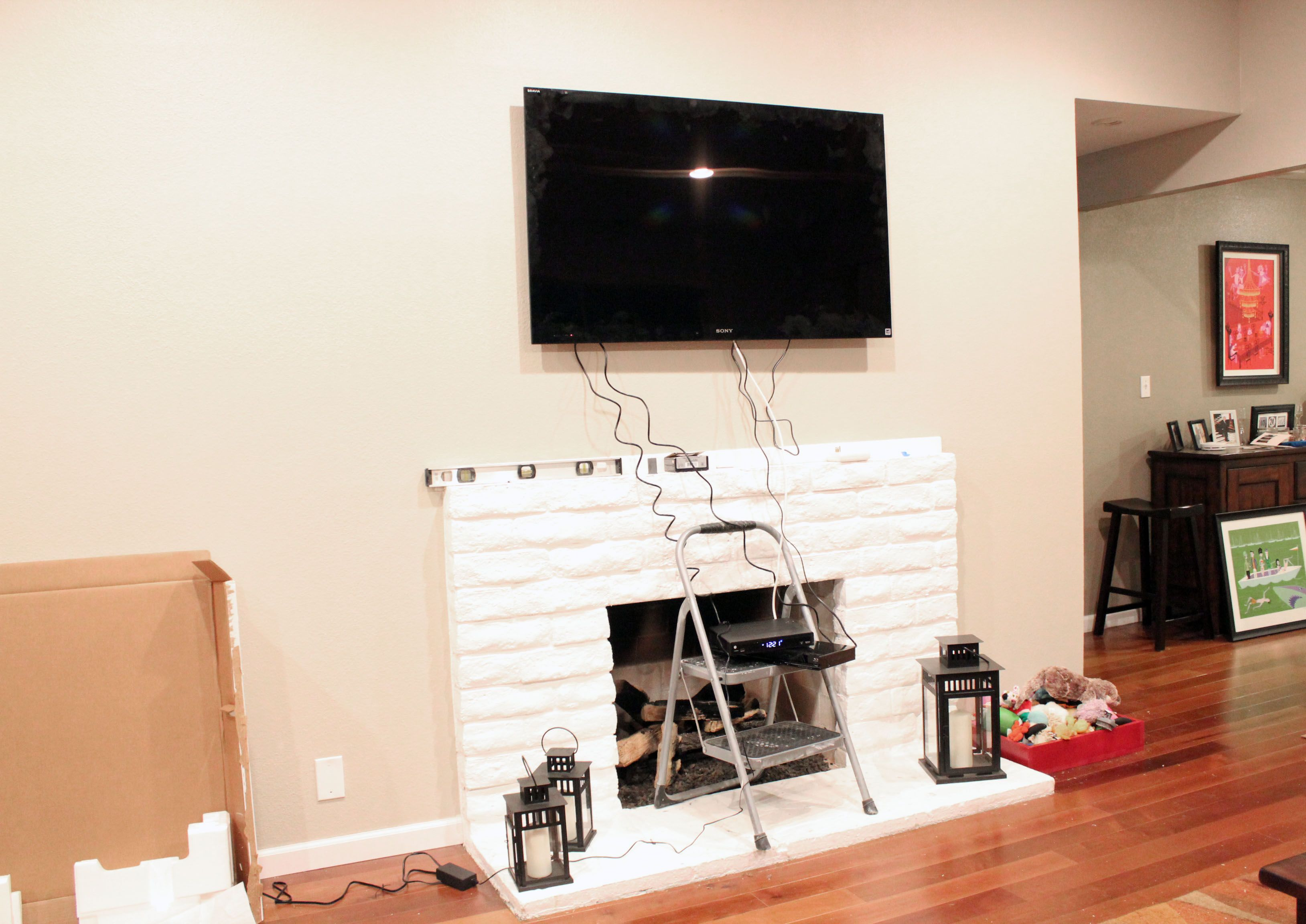 how to hide wires and components for tv mounted over fireplace ...