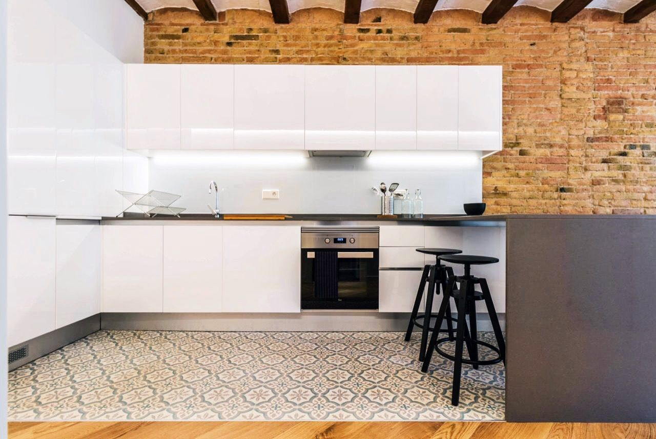 Modern kitchen that holds its authenticity as the vaults and the tiles shoes the kitchen's character
