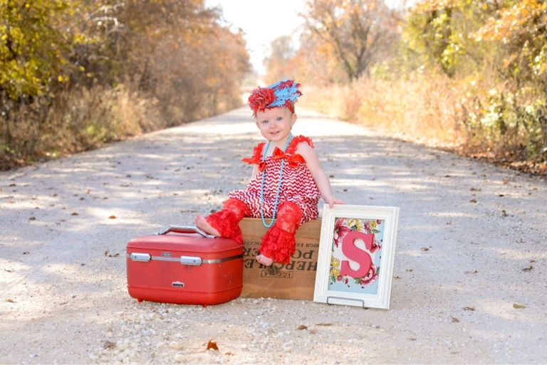 More 1st yr fun photo op vintage train case and hanky initial. Country photo backdrop