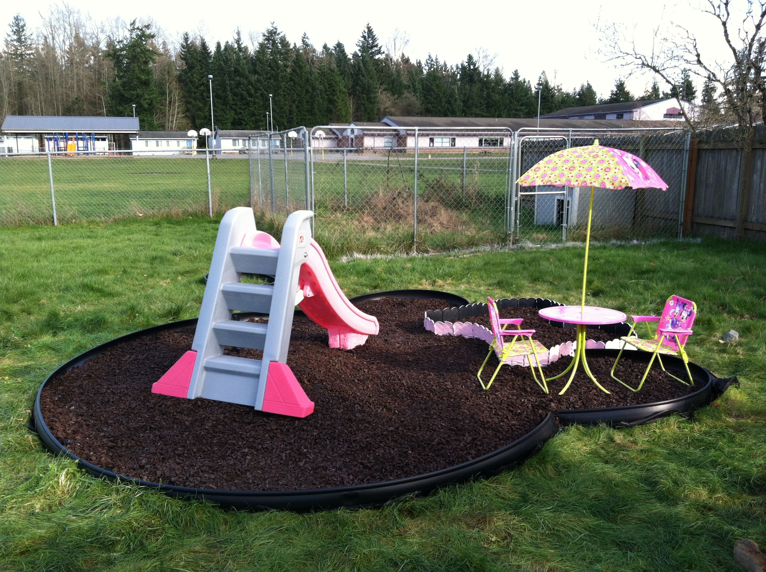 Minnie Mouse Playground: Brown Rubber Mulch, Pink Step2 Slide, And Minnie Patio  Set