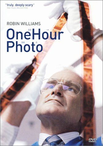 a review of the movie one hour photo He glances in a mirror that reads check your smile he's wearing the company uniform his sandy hair is short and patchy no one has run their fingers through that since a kid at school tried to scalp him.