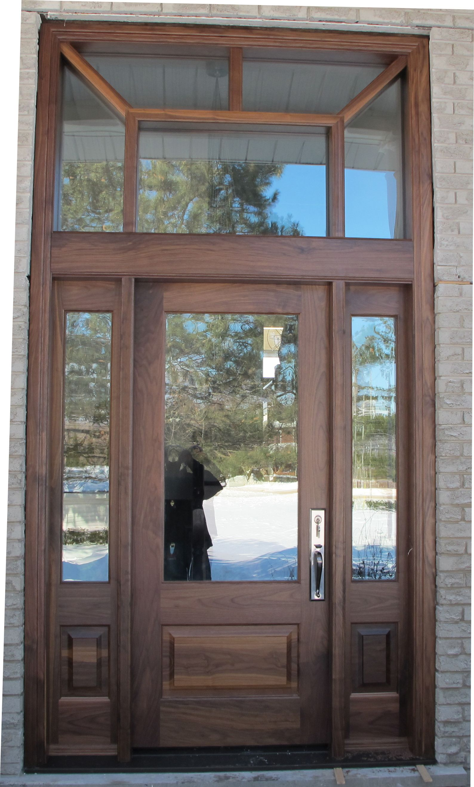 Beautiful Custom Door In American Walnut With Glass Transom And Sidelights Finished With A Clear Beautiful Front Doors Garage Door Design Stained Doors