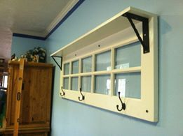 An Old Door Made Into A Shlef Photo Frames Coat Rack With