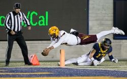 Arizona State Sun Devils quarterback Manny Wilkins (5) dives above California Golden Bears safety Luke Rubenzer (17) but is ruled out of bounds at the four yard line during the third quarter at Memorial Stadium. The California Golden Bears defeated the Arizona State Sun Devils 48-46.  #8960655