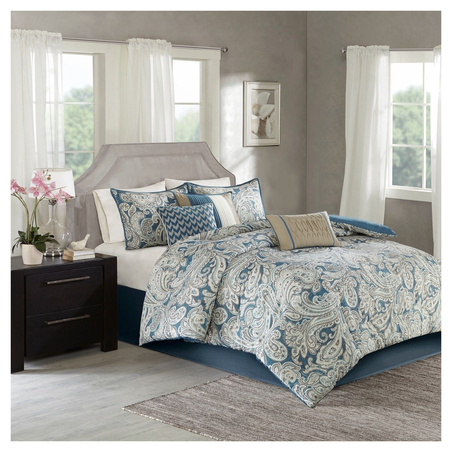 The Celena Comforter Set mixes a classic design with a contemporary color scheme to give you a charming bedding collection. The comforter features a classic paisley pattern that is perfectly contrasted against a rich, vibrant background. Three decorative pillows follow the same top of bed color scheme to pull together the entire collection. Two shams and one bed skirt are included with the comforter and three decorative pillows to complete this set.