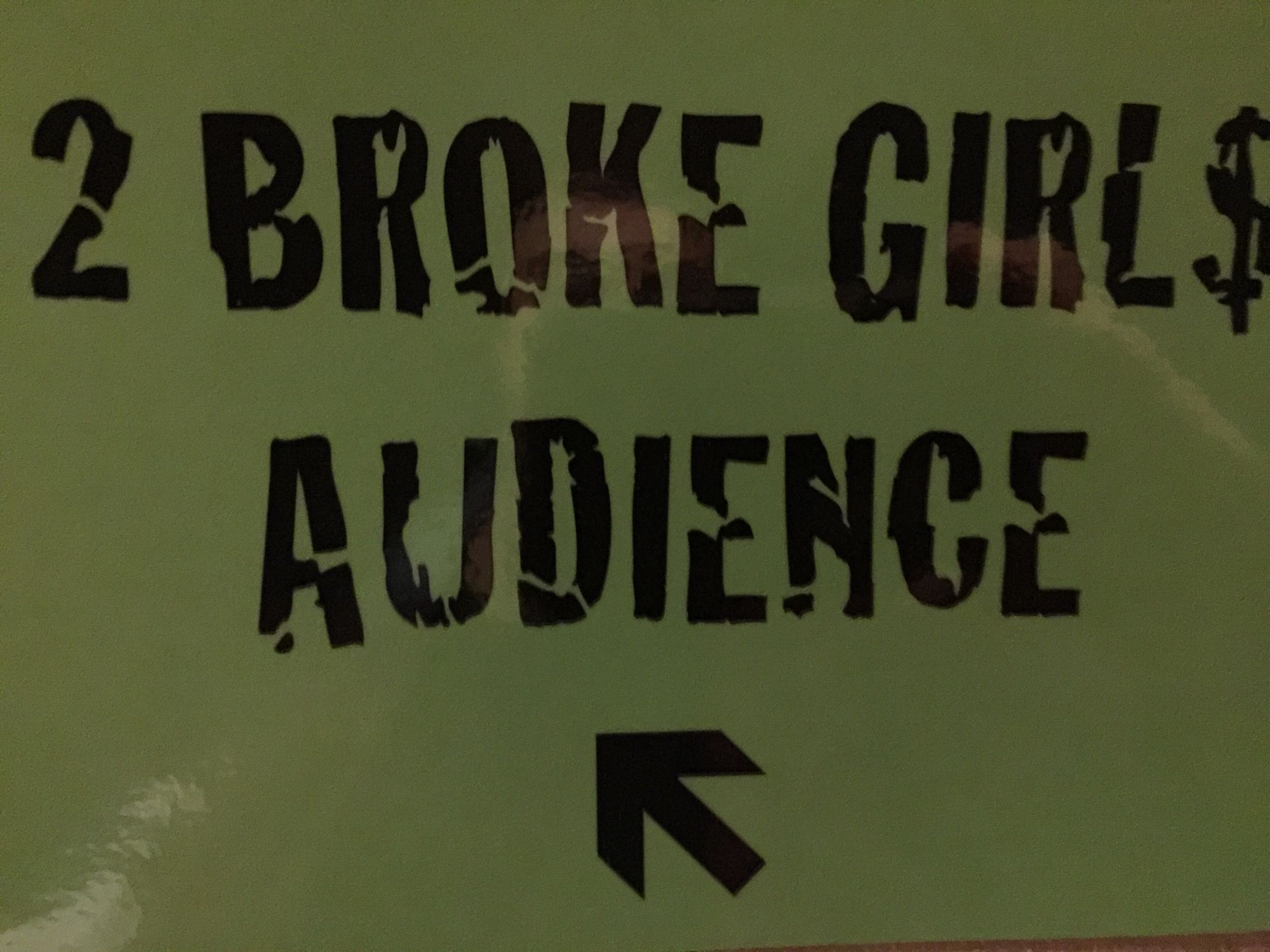 2 Broke Girls Audience sign on stage.