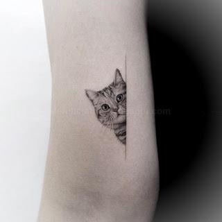 20 Unique Cat Tattoos Cat Tattoo Derelictattoo A Site That Will Rule All Tattoos In 2020 Cat Tattoo Cat Tattoo Small Cute Cat Tattoo