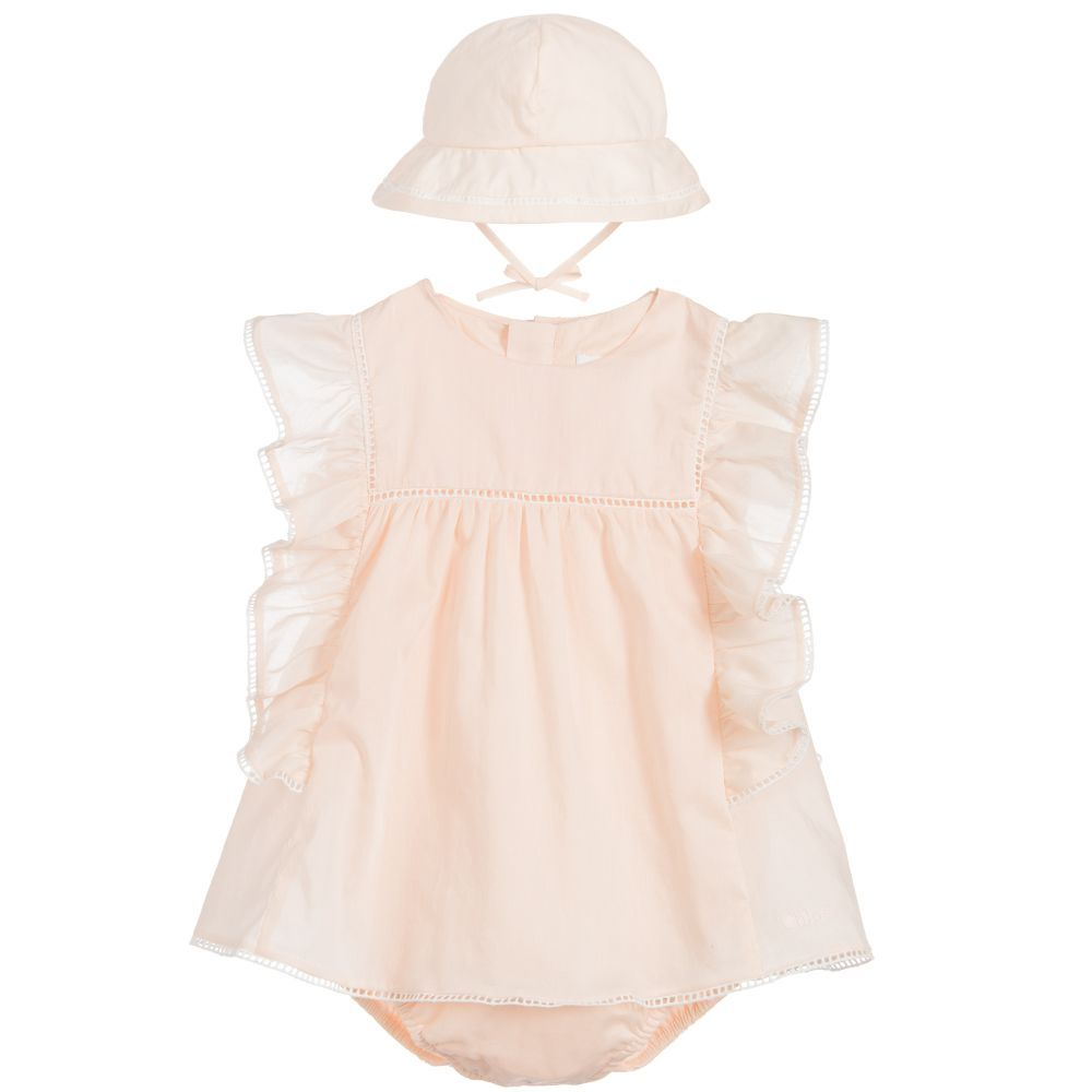 5beddbe976f6a Baby girls will look super cute in this short Chloé dress with ruffle  shoulder detail and ladder style trim. The fitted body fastens between the  legs to ...