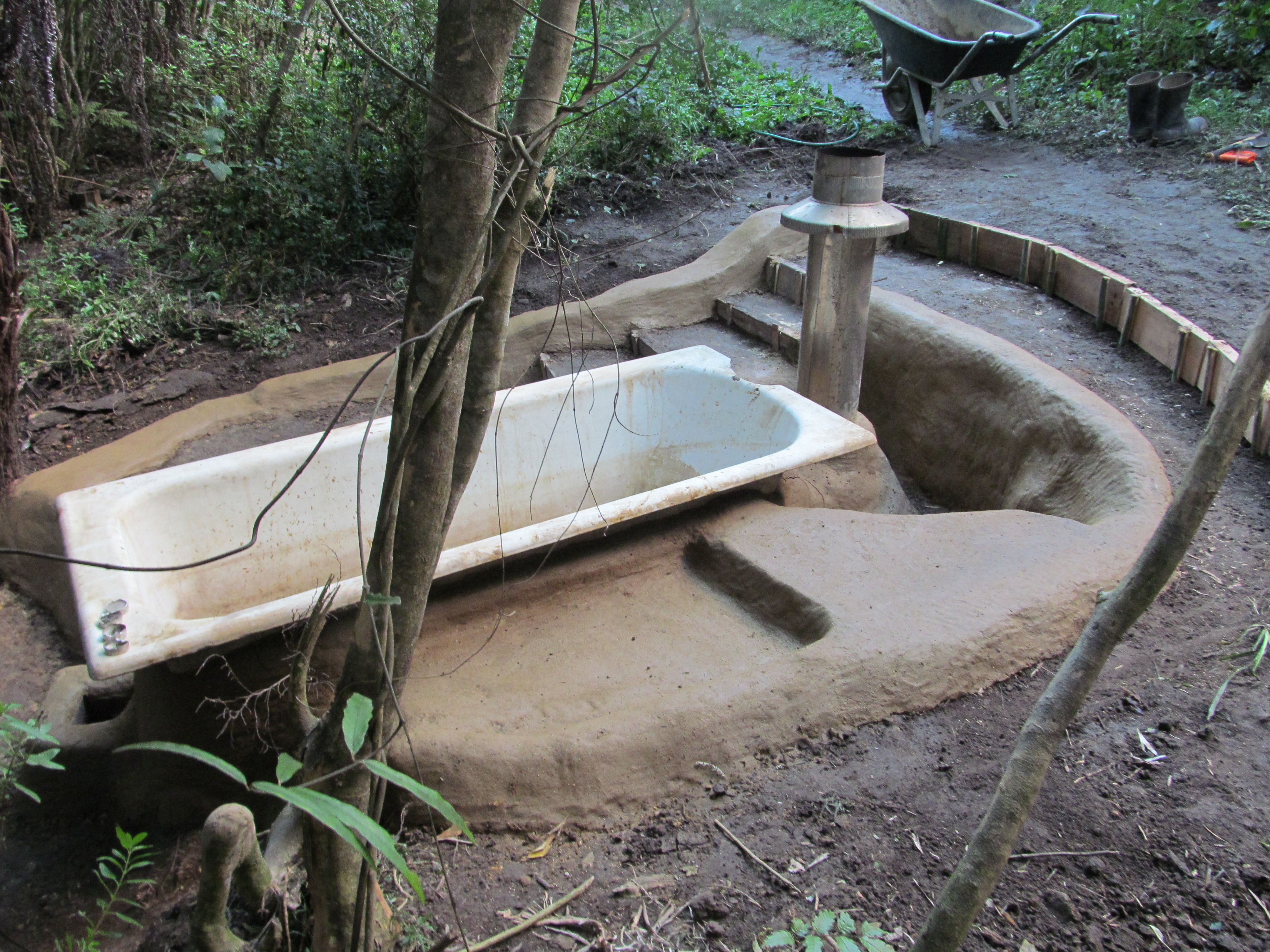 The new rocket stove fire bathtub gets a cobbing rocket for Brick jet stove