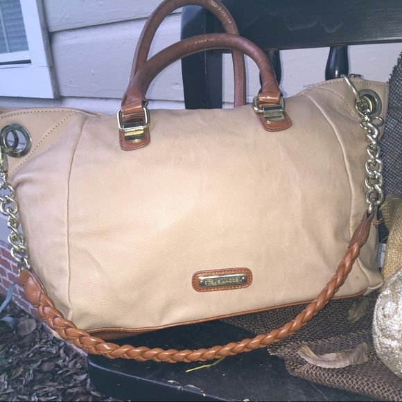 Steve Madden!  Tan leather Steve Madden with pretty brown handles and detachable extender. Nice size very roomy. Preloved it does have some stains on the back as shown above but the front is intact and beautiful. Has back pocket. Inside zipper pocket and two more pockets for extra room. Steve Madden Bags Shoulder Bags
